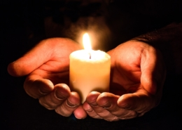 hands with candle light